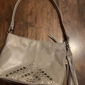 The sak studded gray leather handbag